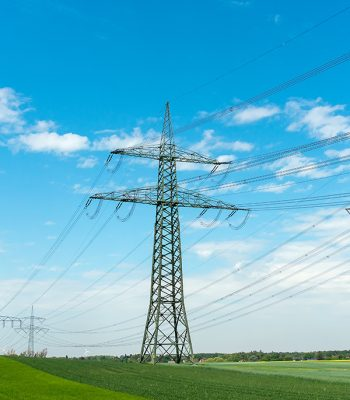 high-voltage-lines-on-a-sunny-day-R2MJQXF